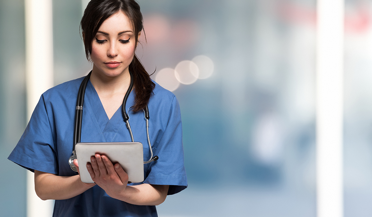 Nurse using eSOURCE tablet ipad RealTime clinical research trials studies